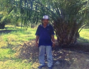Haji A Damit di kebun sawit
